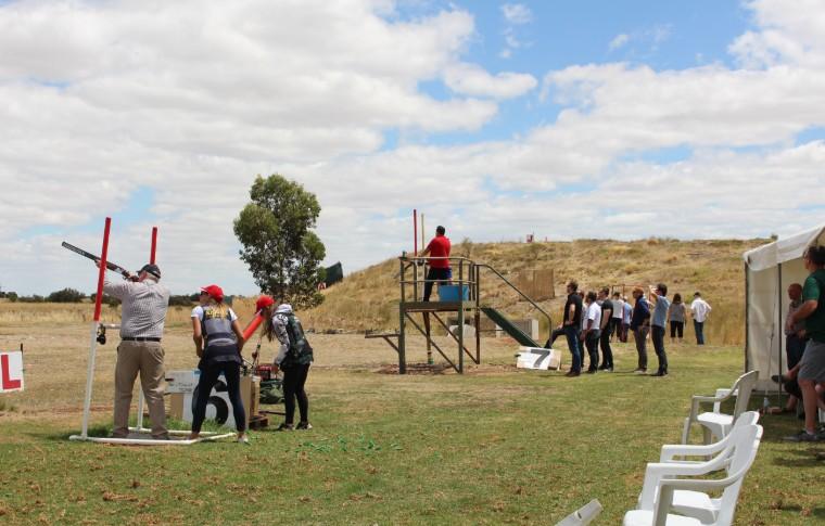 various people with guns at gun range